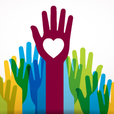 A group of raised hands. The hand in the middle has a heart on their palm.