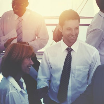 Salesperson and customers engaging at an industry event