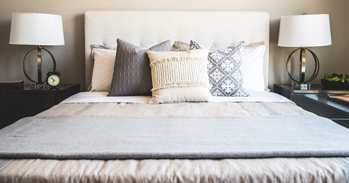 A bed that is made and expertly staged