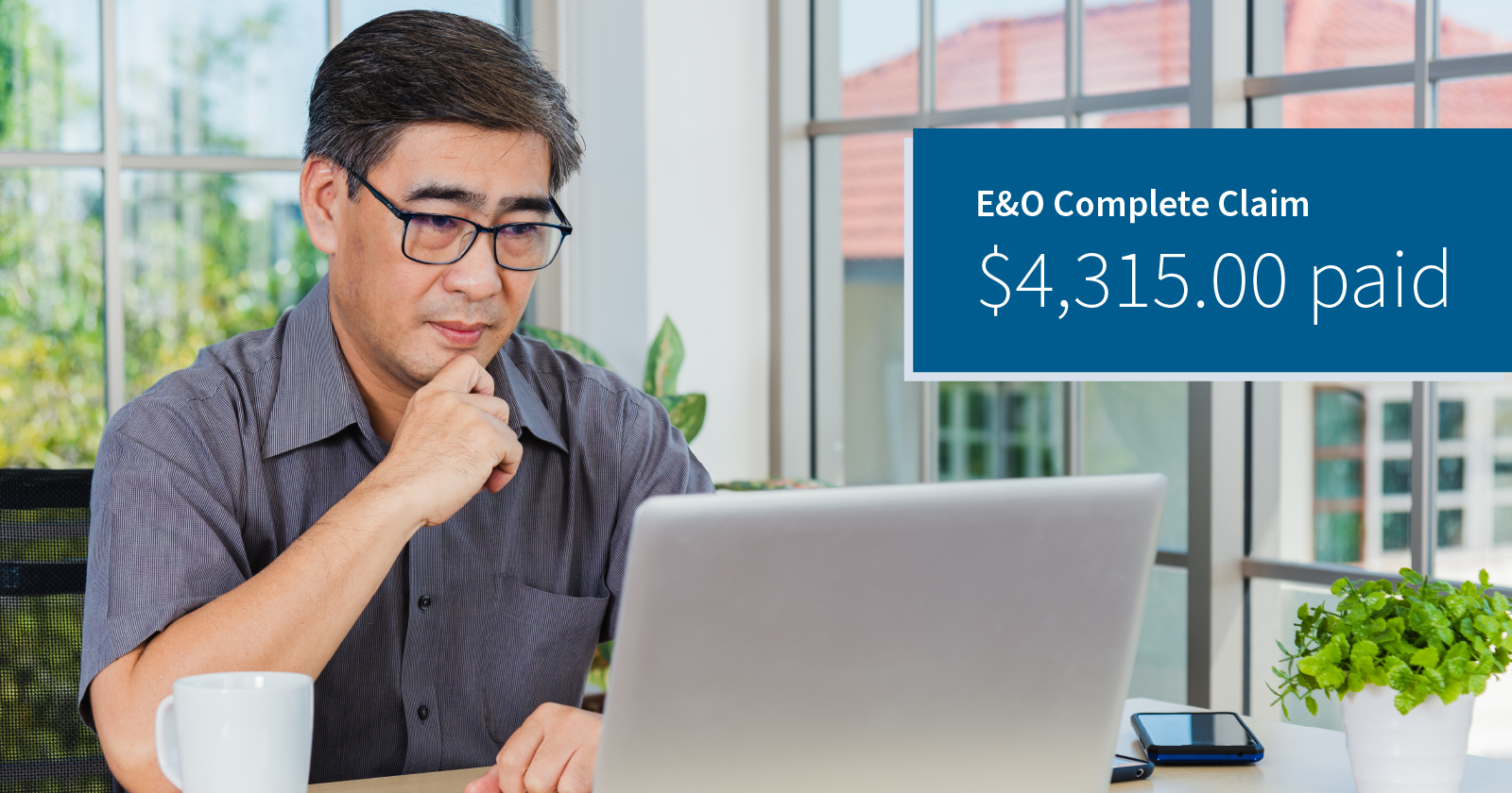photo of a legal professional in a home office looking at his computer with concern. Caption: E&O Complete claim $4315.00 paid