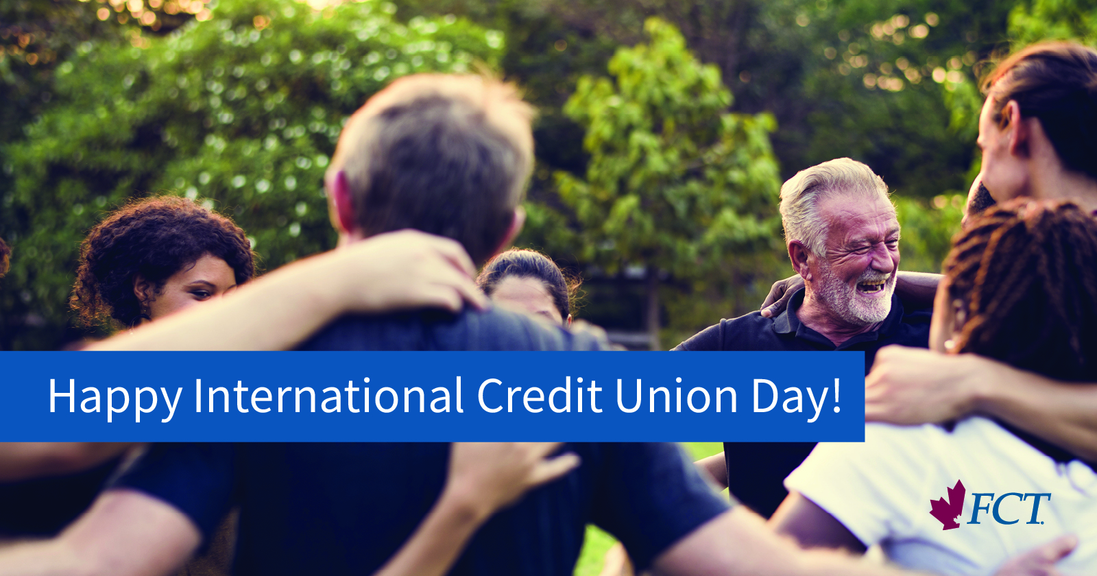 "People hugging and laughing. Copy on the image reading ""Happy international Credit Union Day!"" with an FCT company logo in the bottom right corner."
